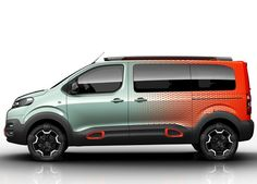 Exterior colour is again a two-tone trick, the light sea-green paint of the front end diffusing into the dark orange towards the rear. The strap motif again appears on the wheels and the bumpers in orange, in anodised aluminium.