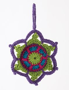 Jewelled Snowflake Jewel tone snowflakes are wrapped in metallic to add dimension to your tree.