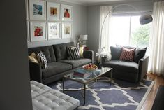 a modern living room I like. Shades of gray with pops of all different colors.