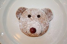 Polar Bear Pancakes- 1 large pancake and 2 small ones for the nose and ears, a grape nose and chocolate chip eyes.