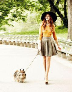 Elegant hat, mustard cardigan, and a high-waist skirt