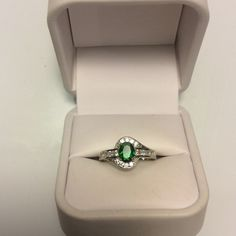 Green Emerald white topaz Ring Beautiful green gemstone Emerald center stone. White topaz encrusted and surround band. White gold plated over silver. Size 6. Brand new. Never worn. Wrapped and shipped with care. No box included. Ice Jewelry Rings