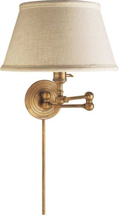 boston swing arm wall lamp with off-white linen shade, antique brass finish