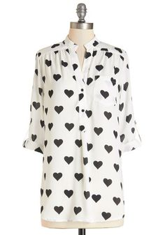 Love Ballad Tunic in White. Show how fun it is to experience that fluttering feeling by wearing this sheer white tunic, which touts a sentimental, solid black heart print, and you just may make others bat their lashes, too! #whiteNaN