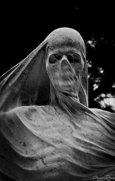 Shrouded face of death (carved stone sculpture at the grave of Spanish industrialist and politician Nicolau Juncosa by sculptor Antoni Pujol. The sculpture is located at the Montjuïc Cemetery in Barcelona) Memento Mori, Zombies, Scary, Creepy, Cemetery Art, Cemetery Statues, Mystic Messenger, Skull Art, Vanitas
