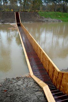 """The Moses Bridge, a """"sunken"""" bridge in Halsteren, The Netherlands by RO Architecten"""