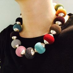 Ulli Kaiser http://ullikaiser.co.uk Crocheted bead and silver necklace with a hidden magnetic clasp.