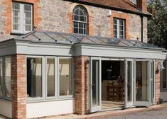 break fronted orangery with brick piers and bifold doors Orangery Extension, Rear Extension, Extension Ideas, Potting Sheds, Kitchen Dinning, House Extensions, House Front, Victorian Homes, Hardwood
