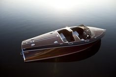 OK, I were to own a boat and had my choice of anyone. This would be it.   Chris Craft