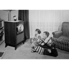 Two brothers and sister watching television Canvas Art - (18 x 24)