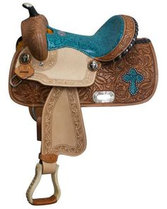 "13"" Double T Barrel style saddle with snake print seat and accents. This saddle features medium oil basketweave tooling on skirts, pommel and cantle. Skirts are accented with floral tooled design and"
