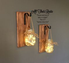How To Make A Hanging Mason Jar Sconces The Easy Way. Are you a fan of mason jars or are trying to find creative ideas with mason jars? For those of you who do not know what mason jars are,… Continue Reading → Mason Jar Sconce, Hanging Mason Jars, 16 Oz Mason Jars, Mason Jar Crafts, Handmade Home Decor, Rustic Decor, Lights, Creative Ideas, Diy Ideas