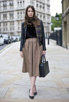 leather jacket with conservative skirt