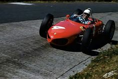 American F1 star Phil Hill piloting his Shark Nose Ferrari 156 around the carousel on the Nurburgring at the 1961 German Grand Prix . Hill went on to claim the World Drivers' Championship at the conclusion of the '61 F1 season.  #ScuderiaFerrari #RedSeason