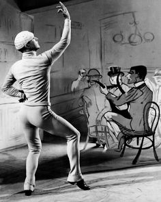 Gene Kelly in An American in Paris (1951, dir. Vincente Minnelli) Art director Preston Ames designed the set in the style of Henri de Toulouse-Lautrec's painting Chocolat Dancing In Bar Darchille.