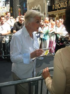 The Angela Landsbury at the stage door meeting fans and signing autographs.