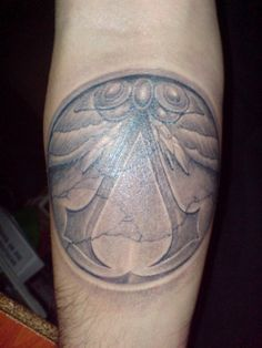 Another tattoo with the Assassin's Order's symbol using shades instead of plain black.