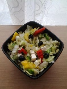 Simple greek salad:  -black olives  -red, yellow, green peppers -lettuce -cucumber or tomato -feta cheese (apetina) All chopped in small peaces  dressing made of olive oil, oregano, little bit of garlic,black pepper