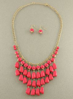 "The Oxford Trunk ""Pebbles"" Necklace in Fuchsia, $16.50"