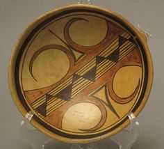 """This is a very beautiful Hopi yellowware bowl by Nampeyo, made around 1905-1910.  It measures 8 1/4"""" diameter and is in excellent original condition. It features a lug for hanging on the back and the extra coil on the rim typical of Nampeyo's work.  This finely painted bowl comes with a letter of authenticity. The drawing is extraordinary, a fine mix of prehistoric Hopi elements combined with Nampeyo's own mature talent."""