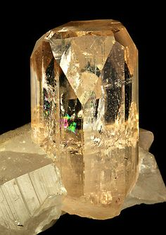 Cut and Polished Imperial Topaz surrounded by Quartz-inside the Topaz you will see a Phantom Crystal and a sheen of color refracted by light