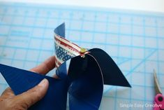 These fun and easy of July Table Decorations make any table sparkle! Learn how to make pinwheels with colorful patriotic colors. Paper Flower Centerpieces, Paper Flowers, How To Make Pinwheels, 4th Of July, Homemade, Table Decorations, Crafts, Joy, Manualidades