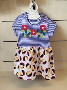 Adorable dress with flower applique and beach ball print skirt.  Available from our shop in sizes 0-6m up to 3-4yr. £28