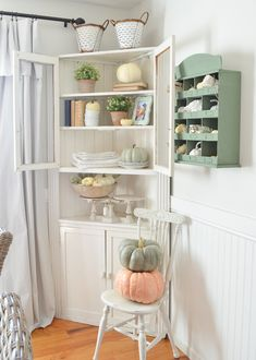A Simple Fall Corner Cabinet. Farmhouse style fall decorating ideas for your home. Easy and simple fall decor! #sarahjoyblog #falldecor #falldecorating #pumpkins
