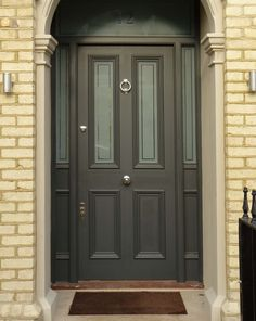 An imposing front door style for a Victorian house. This impressive Victorian front door has opaque etched glass panelling and chrome door furniture. An imposing front door style for a Victorian house. This impressive Victorian front d Exterior Front Doors, Victorian Homes, House Front, Victorian Front Doors, Victorian Door, Victorian Terrace, Wooden Front Doors, Front Door Styles, Wooden Door Design