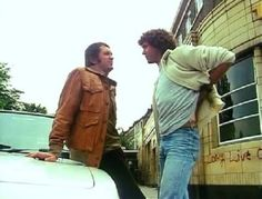 Bodie and Doyle confer