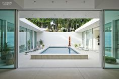 Love how this pool is outdoor w/ immediate access to the indoors and construct provides so much privacy