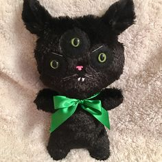 A personal favourite from my Etsy shop https://www.etsy.com/uk/listing/492427024/three-eyed-black-evil-cat-plush-kitten