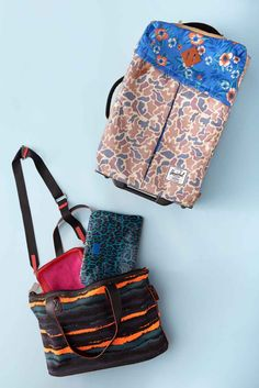 """Tip #2: Take advantage of your carry-ons. When flights get full and airport attendants start looking around for victims volunteers to check their bags, they'll usually go after folks with hard-shell, rolling suitcases first. This piece of Herschel luggage is soft, wildly patterned, and — when tilted on its side — can go incognito as a duffle. But, inside, the suitcase is huge, and the soft case allows you really pack it within an inch of its life.  As for your """"personal item,"""" don't waste it…"""