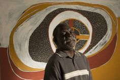 """The winner of the Telstra National Aboriginal and Torres Strait Islander Art Award, Tiwi Island Artist Timothy Cook, with his work """"Kulama"""" at the Museum & Art Gallery of the Northern Territory in Darwin."""