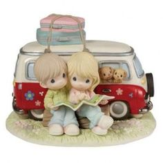 """A road trip can bring two people closer like no other type of vacation can. A very special limited edition, this piece is 15% larger than standard figurines and features blue eyes. Strictly limited to just 3,000 figurines worldwide, it features two happy travelers deciding upon the route they will take to their next adventure. Porcelain. 7"""" H."""