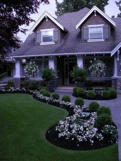What a beautiful modern landscape design that really draws focus to the front door, as any good landscaping should!