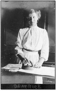 Photo: Domestic servant, Beatrice, ironing, 1906