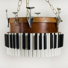 Oh, I do like this one, too.  Piano keys around an old drum shell.  Great idea for a lamp!