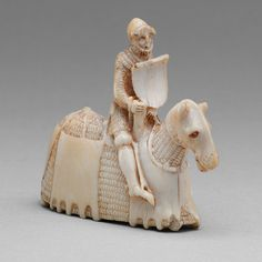 Chess piece (knight), ca. 1350–60 Western European (perhaps English) Ivory Once a piece of exquisitely carved small sculpture, this ivory chessman is today an important document for the study of late medieval horse armor. It gives a rare and remarkably detailed representation of a complete armor for both man and horse of the mid-fourteenth century. MetMuseum, USA