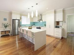 Classic island kitchen design using floorboards - Kitchen Photo 425295