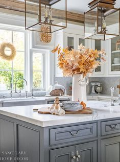Fall decorating ideas for a neutral farmhouse kitchen. Simple steps to add fall color to your kitchen with copper and soft wheat tones.
