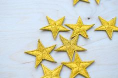 1 Dozen Tiny Gold Embroidery Star Patches with Fine Metallic Thread. Denim Jacket Embroidery, Gold Embroidery, Fabric Glue, Pin And Patches, Metallic Thread, Party Accessories, Childrens Party, Gold Stars, Baby Headbands
