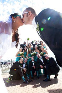 Creative bridal party photo  Love the groomsmen's socks!