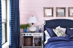 Pink walls and navy blue accents in this awesome bedroom
