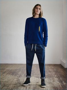 Ton Heukels is a vision of leisure in a zip front sweater and joggers from YMC x River Island collection.