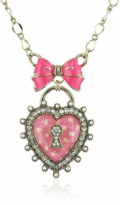 "Betsey Johnson ""Essentials"" Polka Dot Heart Pendant Necklace Betsey Johnson. $45.00. gold tone necklace chain, pink and white polka dot crystal heart lock pendant outlined with pave crystal accents and glass pearls, pink bow with gold tone details. Made in China. gold tone necklace chain, pink and white polka dot crystal heart lock pendant outlined with pave crystal accents and glass pearls, pink bow with gold tone details Made in CN. Items that are handmade may vary in ..."