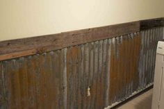 Rusty Tin Wall... love this! All the better if it has a bit of 'old paint' on it. Look for it in junk yards.