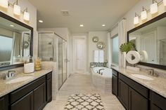 Cross Creek Ranch Model Home Open Daily - 4,098 Sq. Ft.- Master Bathroom - #PerryHomes #trustedbuilder #homebuying #homebuilding #CrossCreekRanch #FulshearTX #KatyISD #KatyHomes #KatyTX #HoustonHomes #openconcept #openfloorplan #familyhome #realestate #RelocatingtoHouston #lakesidecommunity #lakesideliving #landscaping #brickexterior #stoneexterior #masterbath #masterbathroom #gardentub #bathroomvanities #vanitylighting #bathroomtile