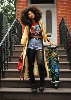 Long yellow trench coat with high waisted jean shorts and a belly-T. And a skateboard.