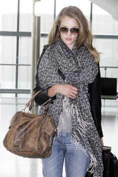 A scarf. Keeps you warm on a plane, changes up an outfit and dresses up a basic look.
